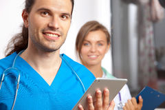 Two young happy medical people Stock Photography