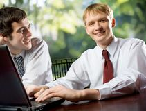Two young happy smiling business men or students Royalty Free Stock Photo