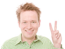 Two. Young happy smiling man showing the number two on his fingers - isolated on white and retouched (As this is part of a series going from 1 to 10, you can Royalty Free Stock Photo