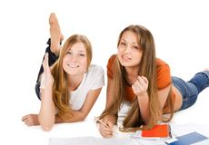 Two young happy student girl, isolated on white Royalty Free Stock Photos