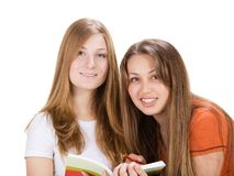 Two young happy student girl, isolated on white Royalty Free Stock Images