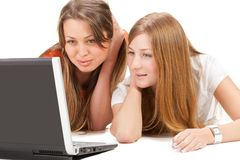 Two young happy student girl work on laptop Royalty Free Stock Image