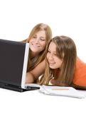 Two young happy student girl work on laptop Stock Photo