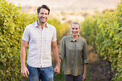 Two young happy vintners holding hands Stock Photo