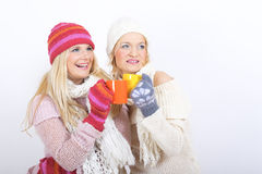 Two Young Happy Winter Woman With Cup Of Tea Stock Photo