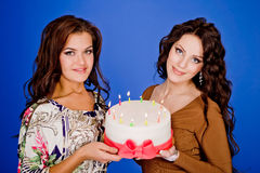 Two young happy woman with a gift Royalty Free Stock Photos
