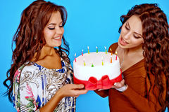 Two young happy woman with a gift Royalty Free Stock Image