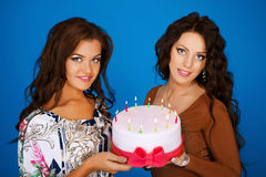 Two young happy woman with a gift Stock Image