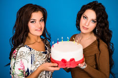 Two young happy woman with a gift Royalty Free Stock Photography