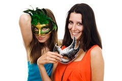 Two young happy woman at party with italian masks Royalty Free Stock Images