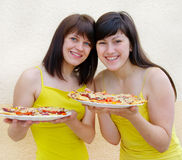 Two young happy women Stock Photos