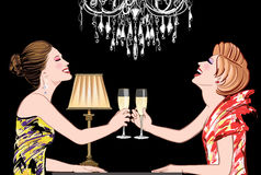 Two young happy women with champagne glasses Royalty Free Stock Photo