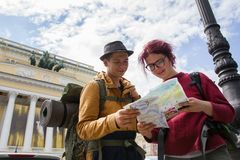 Two young hikers are looking at the map. Telephoto shot Royalty Free Stock Image