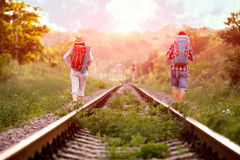 Two young Hikers walking along old Country Railroad Stock Image