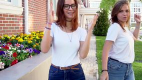 Two young hipster girl friends dancing outdoor slow motion. HD stock footage