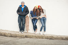 Two young  hipster girl friends and guy Royalty Free Stock Photo