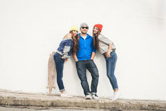 Two young  hipster girl friends and guy Royalty Free Stock Images