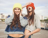 Two young  hipster girl friends Royalty Free Stock Image