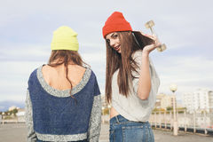 Two young  hipster girl friends Stock Images