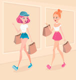 Two young hipster girls going down the street, with shopping bags and talking with each other. Vector illustration. Stock Photo