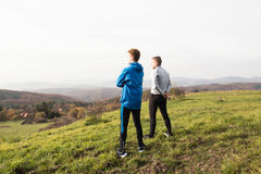 Two young hipster runners in sunny autumn nature restinng Stock Photo