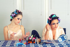 Two young housewives beautifying themselves at home Stock Photo
