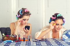 Two young housewives beautifying themselves at home Royalty Free Stock Photo