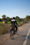 Two young indian boys on bicycles Royalty Free Stock Photo