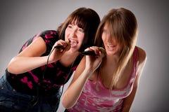 two young karaoke girls Stock Image
