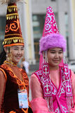 Two young Kazakh women in traditional clothes Royalty Free Stock Images
