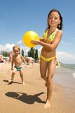 Two young kids having fun at the beach Royalty Free Stock Photo