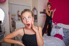 Two young kids playing in their room Stock Photo