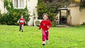 Two young kids running in slow motion towards the camera. Young boy and girl running in slow motion towards the camera stock video footage