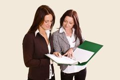 Two young ladies studying file Royalty Free Stock Images
