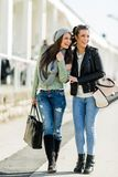 Two young ladies walking and shopping happily Royalty Free Stock Photography