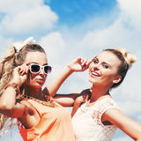 Two young lady in summer apparel pose for the camera Stock Photo