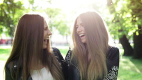 Two young laughing women stock footage