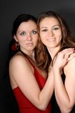 Two young lesbian girl friend. On gray background Stock Image