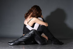 Two young lesbian girl friend. On gray background Royalty Free Stock Images
