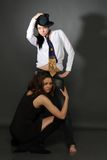 Two young lesbian girl friend. On gray background Royalty Free Stock Photos