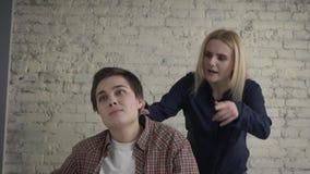 Two young lesbian girls quarrel, misunderstanding, conflict, scandal, blonde screams at her partner. 60 fps. 4k stock video footage