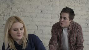 Two young lesbian girls quarrel, misunderstanding, conflict, scandal, grief, a young family, a girl with short hair. Yelling at her partner. 60 fps 4k stock video