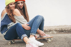 Two young  longboarding girl friends Stock Photos