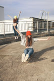 Two young  longboarding girl friends Royalty Free Stock Photos