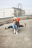 Two young  longboarding girl friends Royalty Free Stock Photography