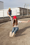 Two young  longboarding girl friends Royalty Free Stock Images