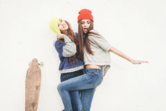Two young  longboarding girl friends Stock Image