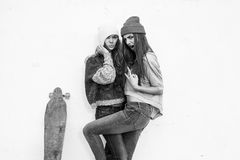 Two young  longboarding girl friends Royalty Free Stock Image