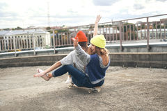 Two young  longboarding girl friends Royalty Free Stock Photo