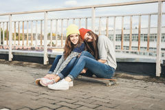 Two young  longboarding girl friends Stock Images
